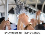 asian people holding handle and ... | Shutterstock . vector #534992503