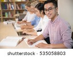 smiling asian student working... | Shutterstock . vector #535058803