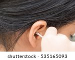 use a cotton bud cleaning the... | Shutterstock . vector #535165093