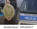 man handcuffed criminal police | Shutterstock . vector #535181017