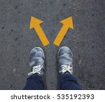 pair of shoes standing on a... | Shutterstock . vector #535192393