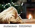 woolen knitwear on red armchair ...