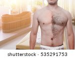 Man Waxing His Chest To...