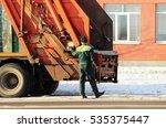 worker standing next to a junk... | Shutterstock . vector #535375447