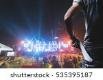 Small photo of Customer presenting tickets or admission passes watch a rock music concert