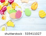 Colorful Easter Cookies On Blu...