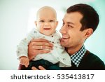 the father holds  hands a small ... | Shutterstock . vector #535413817