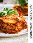 piece of tasty hot lasagna with ... | Shutterstock . vector #535572697