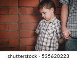 portrait of sad son hugging his ... | Shutterstock . vector #535620223
