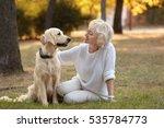 Senior Woman And Big Dog...
