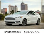 Small photo of MEMPHIS, TN - DECEMBER 7, 2016: A 2016 FORD FUSION HYBRID TITANIUM. The total system output is rated at 188 horsepower. Fuel economy is estimated at 44 mpg in the city, 41 mpg on the highway