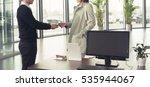 car salesman handing over car... | Shutterstock . vector #535944067