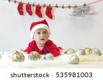 Lying Baby With A Christmas Hat
