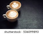 two cups of coffee on black... | Shutterstock . vector #536099893