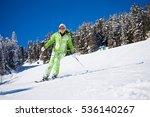 Woman Skiing On Mountain Ski...