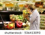 man buying flowers at a garden... | Shutterstock . vector #536413093