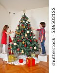 boy and girl decorating a... | Shutterstock . vector #536502133