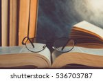 Closeup Of Reading Glasses On...