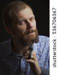 man cuts his beard | Shutterstock . vector #536706367
