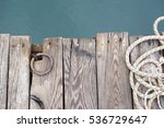 Wooden Deck By  The Sea.