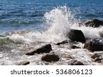 Sea Wave Crashing On Rocks Wit...