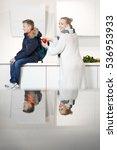 mother preparing his son for...   Shutterstock . vector #536953933