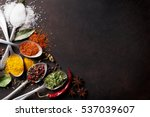various spices spoons on stone... | Shutterstock . vector #537039607