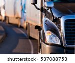 Details of dark semi truck on...