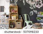 Small photo of Crate regale, chalkboard, chair and rolling cart