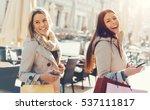 two beautiful smiling women... | Shutterstock . vector #537111817