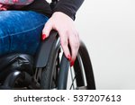 person sitting on wheelchair.... | Shutterstock . vector #537207613