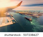 Small photo of container,container ship in import export and business logistic.By crane , Trade Port , Shipping.Tugboat assisting cargo to harbor.Aerial view.airfreight.transportation.