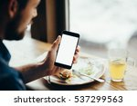 young man looking at phone ... | Shutterstock . vector #537299563