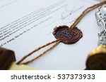 Small photo of Old notarial wax stamp on document, closeup