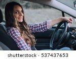 young cute brunette driving a... | Shutterstock . vector #537437653