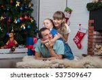 young happy family at christmas ... | Shutterstock . vector #537509647