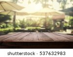empty wood table with blurry... | Shutterstock . vector #537632983