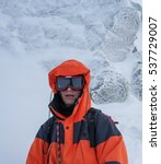 Small photo of Mountaineering. Portret of alpinist.
