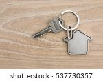 house shaped key in the wood   Shutterstock . vector #537730357