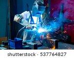 man welding metal in the factory | Shutterstock . vector #537764827