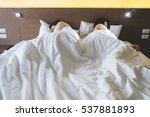asian couple lying on bed... | Shutterstock . vector #537881893