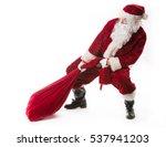 Santa Claus Pulling Huge Bag...