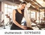 tired girl wiping sweat with... | Shutterstock . vector #537956053