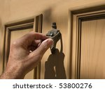 hand_on_door_knocker - stock photo