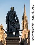 Small photo of Adam Smith Statue from the back, Edinburgh, Scotland, UK