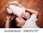 brother hugging his newborn... | Shutterstock . vector #538191757