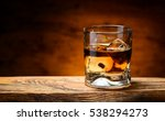 Whiskey With Ice On A Wooden...