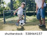 father and son playing in the... | Shutterstock . vector #538464157
