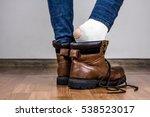 foot in torn sock. taking of... | Shutterstock . vector #538523017