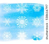 snowflakes on blue watercolor... | Shutterstock .eps vector #538616797